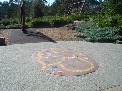 inlaid childrens artwork in concrete path