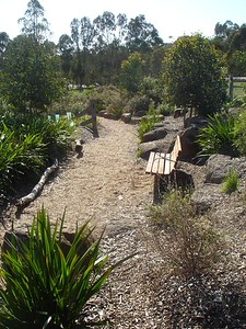 mulch path with boulder edging and bench seat