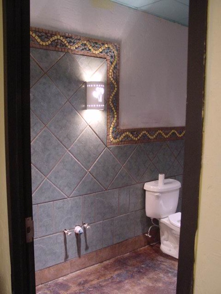 Ladies room new tile but mirror and counter sink not installed yet. How about that yellow mosaic trim?!?!