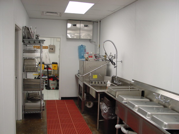 Dishwashing, dry storage room on left, fire suppression system on upper wall.