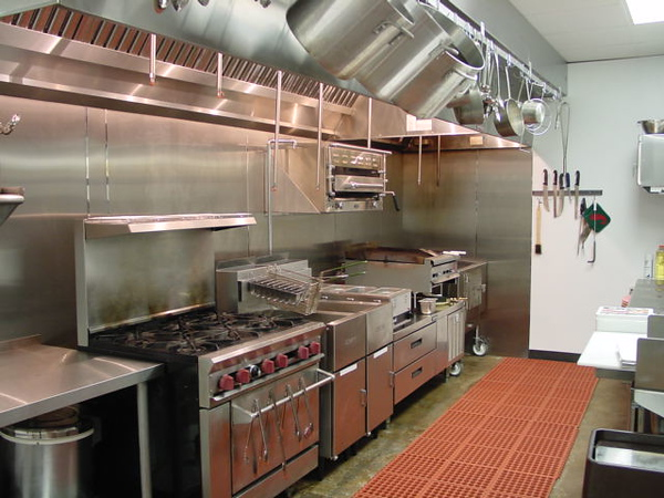 Cook line. Prep table, Six burner, fryer, cold storage below, WOOD BURNING CHARBROILER ($3,800) with separate hood and fire control, Custom made pot/pan rack on front of hood.