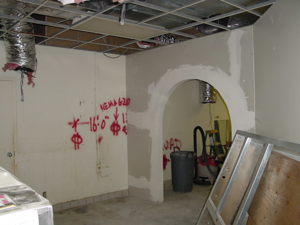 A second arch between the kitchen and secondary serving area. Wall marking for electrician to install wall plugs with types