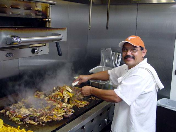 FAJIIIITAS ! Thomas would first precook the skirt steak and chicken on the Mesquite wood burning charbroiler, then when an order came in, he'd finish them off (with red, green, and yellow bell peppers and onions) on the flat top grille.