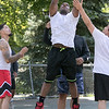 """Friends got together on Saturday to shoot some hoops at the Joanne """"Mama"""" Fitz Memorial Playground's basketball court in Fitchburg. Putting up a shot is Wilson Fisk from Fitchburg. SENTINEL & ENTERPRISE/JOHN LOVE"""