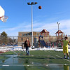 Joey Aresenault, 14, and his uncle Frank Kerrigan, both from Tewksbury played some basketball in the warm weather on Wednesday afternoon at the courts next to the Shawsheen Elementary School in Wilmington. SUN/JOHN LOVE