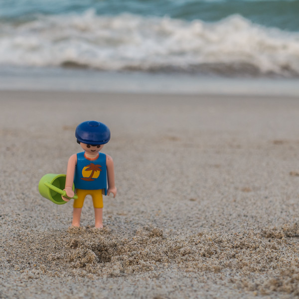 Playmobil beach fun,  waiting for a crab to come out. Melborne Beach, India Atlantic, Florida USA