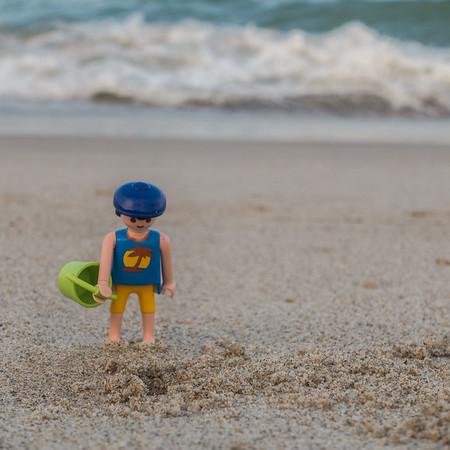 Playmobil beach fun,  waiting for a crab to come out. Melborne Beach, India Atlantic, Florida USA