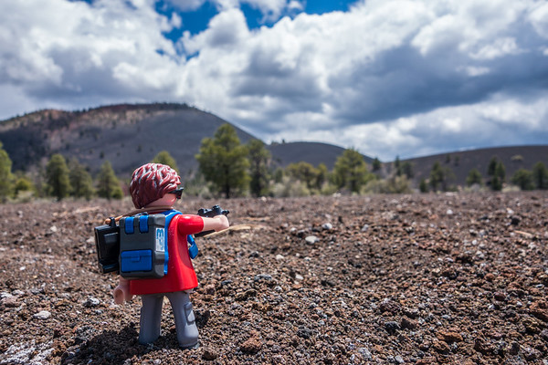 Playmobil photographer at Bonito Flow, Sunset Crater Volcano National monument, Arizona