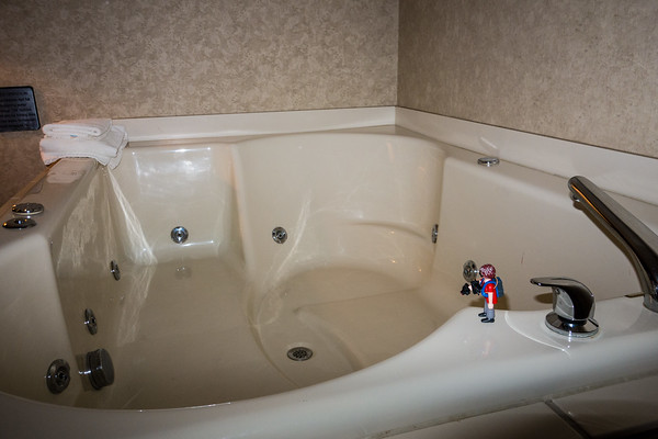 Playmobil checking out the bedside jacuzzi, Cleveland, Ohio USA