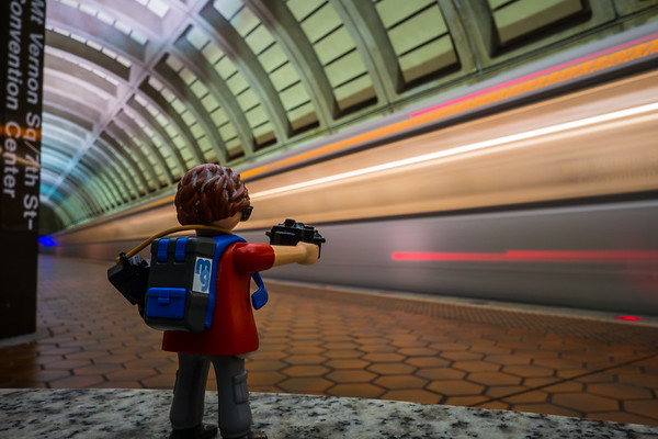 Playmobil photographer taking a long exposure motion blur photo in the Washington D.C. subway