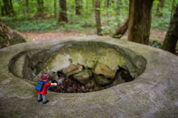Playmobil at an old well. Madison County Nature Trail, Huntsville, Alabama USA