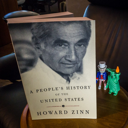 Playmobil Lady Liberty and Uncle Sam refreshing their knowledge after a busy July 4th weekend reading Howard Zinn's A People's History of the United States.
