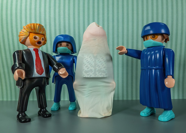 Instructing Trump on how to wear his COVID-19 Body Condom. Playmobil