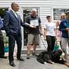 Pleasant Kennels in Leominster held a ribbon cutting on Thursday, July 25, 2019. Leominster Mayor Dean Mazzarella, second from left, gives a proclamation from the city to owner Craig Lemonie, center, and Manager Taryn Lawrence, in hat, during the ribbon cutting.  SENTINEL & ENTERPRISE/JOHN LOVE