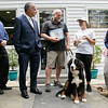 Pleasant Kennels in Leominster held a ribbon cutting on Thursday, July 25, 2019. Leominster Mayor Dean Mazzarella, second from left, gives a proclamation from the city to owner Craig Lemonie and Manager Taryn Lawrence, in hat, during the ribbon cutting.  SENTINEL & ENTERPRISE/JOHN LOVE