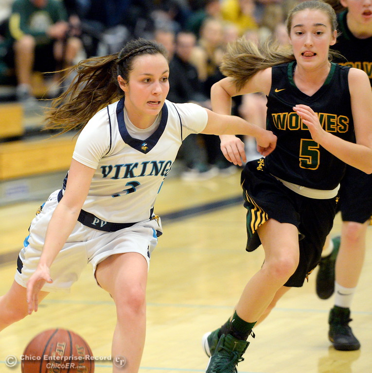. PV #3 Claire Garcia drives past San Ramon Valley\'s #5 Anne Marie Santich during playoff basketball at Varley Gymnasium Tues. March 13, 2018.  (Bill Husa -- Enterprise-Record)