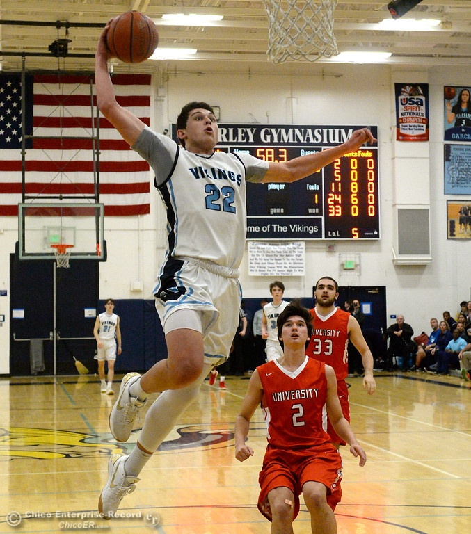 . University\'s #2 Noah Wright and #33 Nadav Shenkar can only watch as PV #22Kevin Kremer goes for the one handed dunk during playoff basketball at Varley Gymnasium Tues. March 13, 2018.  (Bill Husa -- Enterprise-Record)