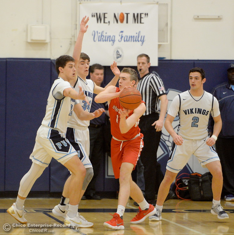 . PV\'s Kevin Kremer, Treyson Keating and Jarin Plander apply defensive pressure to University\'s #11 Spencer Spivy during playoff basketball at Varley Gymnasium Tues. March 13, 2018.  (Bill Husa -- Enterprise-Record)