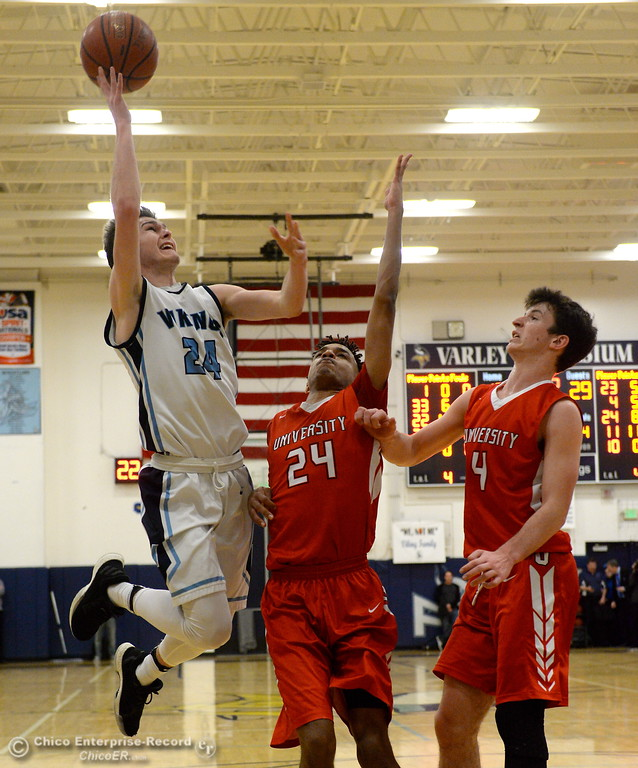 . PV #24 Cody Hamilton goes up for a shot over University\'s #24 Julian Manyika and #4 Max Fried during playoff basketball at Varley Gymnasium Tues. March 13, 2018.  (Bill Husa -- Enterprise-Record)