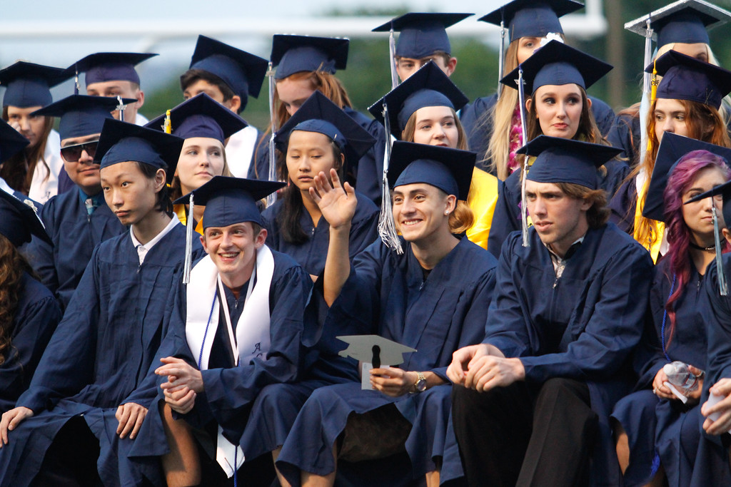 . Pleasant Valley High School students wave to family and friends during the commencement ceremony for the class of 2017 Wednesday June 7, 2017 in Chico, California. (Emily Bertolino -- Enterprise-Record)