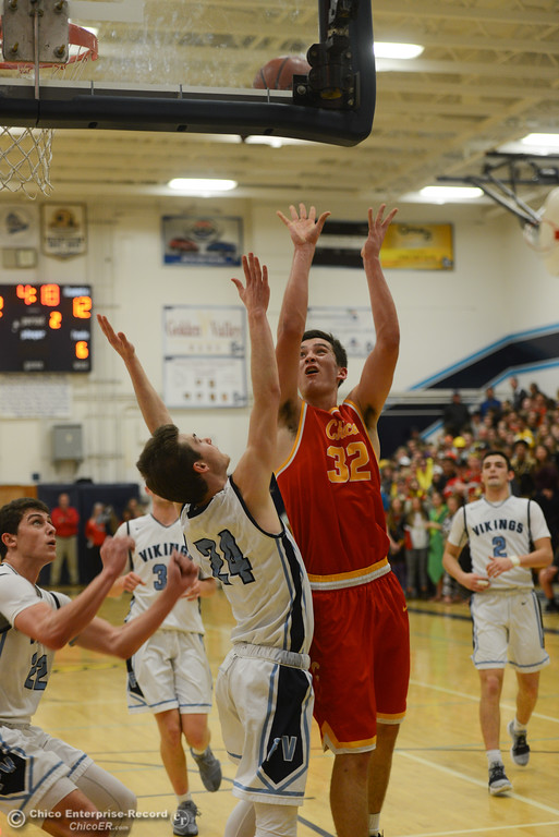 . Chico High\'s Stephen Schaefer (32) goes up for a shot against Pleasant Valley\'s Cody Hamilton (24), Friday, February 9, 2018, in Chico, California. (Carin Dorghalli -- Enterprise-Record)