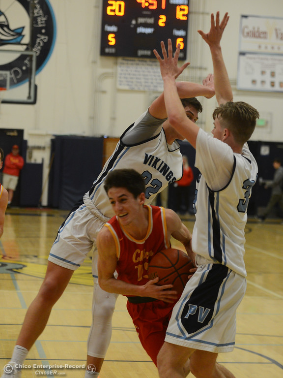 . Chico High\'s Rea Chiles (15) squeezes through Pleasant Valley\'s Jarin Polander (2) and Jake Rick (33), Friday, February 9, 2018, in Chico, California. (Carin Dorghalli -- Enterprise-Record)