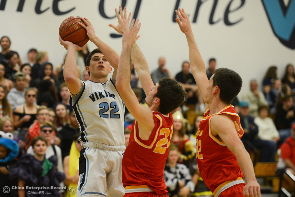 . Pleasant Valley\'s Kevin Kremer (22) goes up for a shot against Chico High\'s Ty Thomas (24) and Stephen Schaefer (32), Friday, February 9, 2018, in Chico, California. (Carin Dorghalli -- Enterprise-Record)