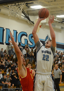 Pleasant Valley's Kevin Kremer (22) goes up for a shot against Chico High's Stephen Schaefer (32), Friday, February 9, 2018, in Chico, California. (Carin Dorghalli -- Enterprise-Record)