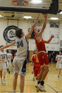 Chico High's Daniel Kelly (5) goes up for a shot against Pleasant Valley's Treyson Keating (34), Friday, February 9, 2018, in Chico, California. (Carin Dorghalli -- Enterprise-Record)