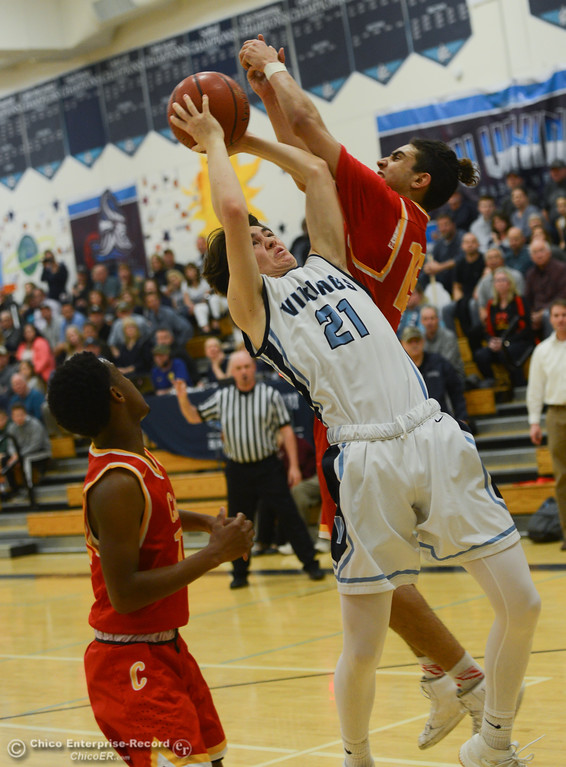 . Pleasant Valley\'s Justice Keating (21) goes up for a shot against Chico High\'s Rea Chiles (15) and Bishop Thomas (11), Friday, February 9, 2018, in Chico, California. (Carin Dorghalli -- Enterprise-Record)