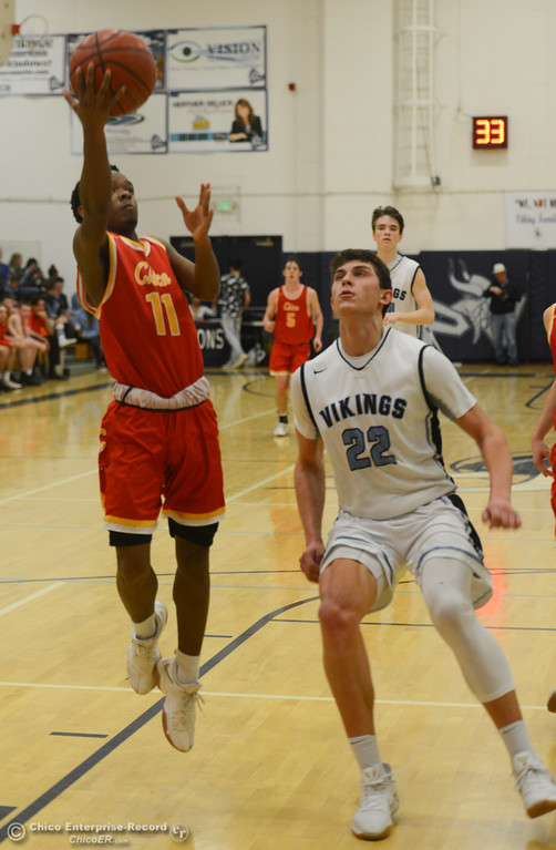 . Chico High\'s Bishop Thomas (11) goes up for a shot against Pleasant Valley\'s Kevin Kremer (22), Friday, February 9, 2018, in Chico, California. (Carin Dorghalli -- Enterprise-Record)