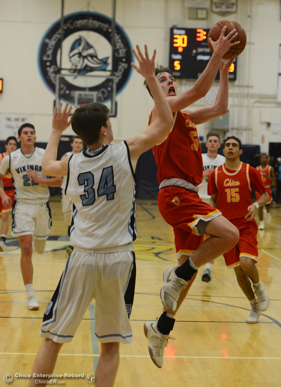 . Chico High\'s Daniel Kelly (5) goes up for a shot against Pleasant Valley\'s Treyson Keating (34), Friday, February 9, 2018, in Chico, California. (Carin Dorghalli -- Enterprise-Record)