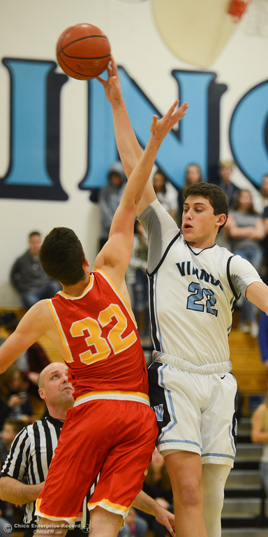 . Pleasant Valley\'s Kevin Kremer (22) and Chico High\'s Stephen Schaefer (32) fight for the ball, Friday, February 9, 2018, in Chico, California. (Carin Dorghalli -- Enterprise-Record)