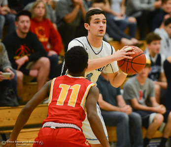 Pleasant Valley's Jarin Polander (2) is guarded by Chico High's Bishop Thomas (11), Friday, February 9, 2018, in Chico, California. (Carin Dorghalli -- Enterprise-Record)