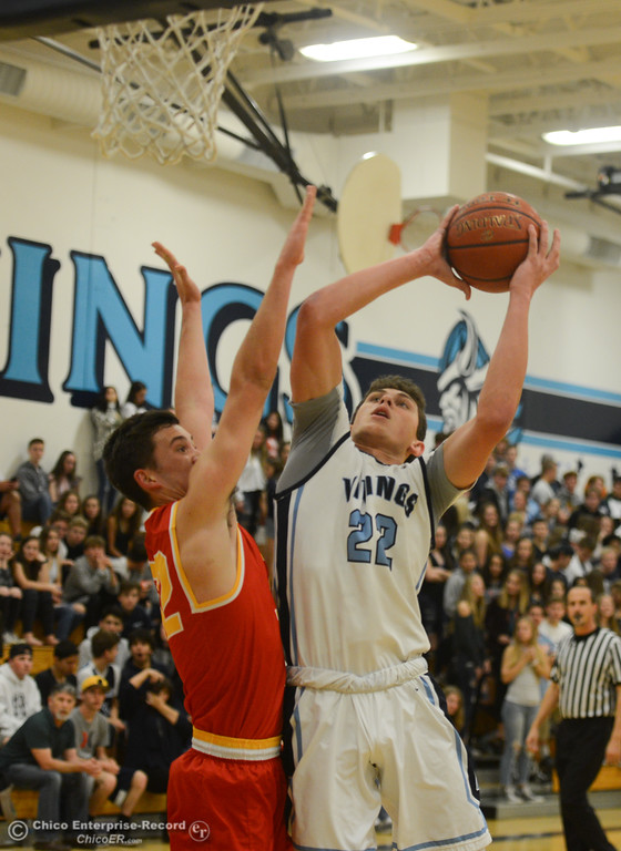 . Pleasant Valley\'s Kevin Kremer (22) goes up for a shot against Chico High\'s Stephen Schaefer (32), Friday, February 9, 2018, in Chico, California. (Carin Dorghalli -- Enterprise-Record)