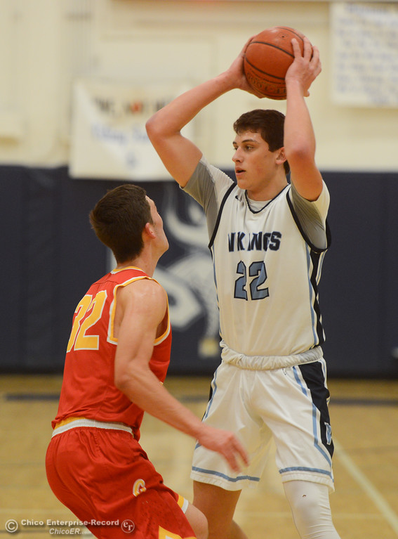 . Pleasant Valley\'s Kevin Kremer (22) is guarded by Chico High\'s Stephen Schaefer (32), Friday, February 9, 2018, in Chico, California. (Carin Dorghalli -- Enterprise-Record)