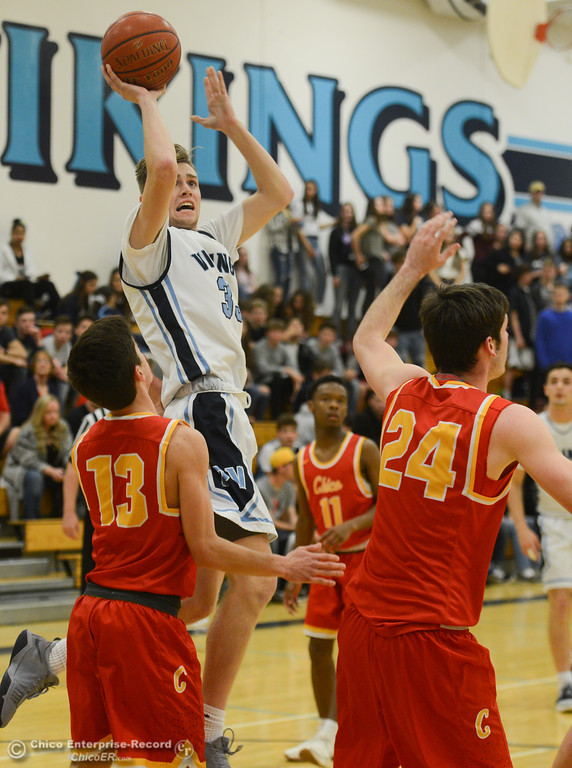 . Pleasant Valley\'s Jake Rick (33) goes up for a shot against Chico High\'s Tyler Willis (13), Ty Thomas (24) and Daniel Kelly (5), Friday, February 9, 2018, in Chico, California. (Carin Dorghalli -- Enterprise-Record)