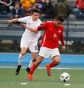Chico High's Brandon Rodriguez tries to keep Pleasant Valley's Daniel Ramirez from getting to the ball during a boys soccer game February 8, 2017 in Chico, California. (Emily Bertolino -- Enterprise-Record)