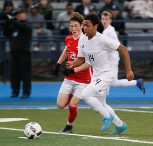 Pleasant Valley's Dante Jackson and Chico High's Rory Monninger race after the ball during a boys soccer game February 8, 2017 in Chico, California. (Emily Bertolino -- Enterprise-Record)