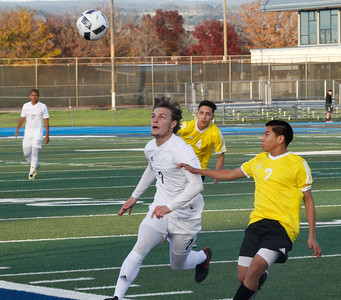 Pleasant Valley's Brad Guymon races after the ball in their season opener soccer game against Live Oak Monday November 28, 2016 in Chico, California. (Emily Bertolino -- Enterprise-Record)