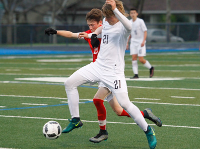 Pleasant Valley's Logan Hall wedges in to steal the ball away from Chico High's Rory Monninger during a boys soccer game February 8, 2017 at Pleasant Valley in Chico, California. The Vikings went on to defeat the Panthers 2-1. (Emily Bertolino -- Enterprise-Record)