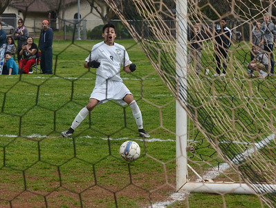 PV's Daniel Rodriguez watches in disbelief as his wide-open shot bounces left and out-of-bounds before reaching the goal in the Northern Section boys soccer final Saturday, Feb. 27, 2016, between Pleasant Valley and Shasta high schools in Chico, California. (Dan Reidel -- Enterprise-Record)