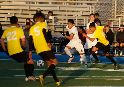 Pleasant Valley's Daniel Rodriguez races through a sea of Live Oak players to later score the first goal of the night in their season opener soccer game Monday November 28, 2016 in Chico, California. (Emily Bertolino -- Enterprise-Record)