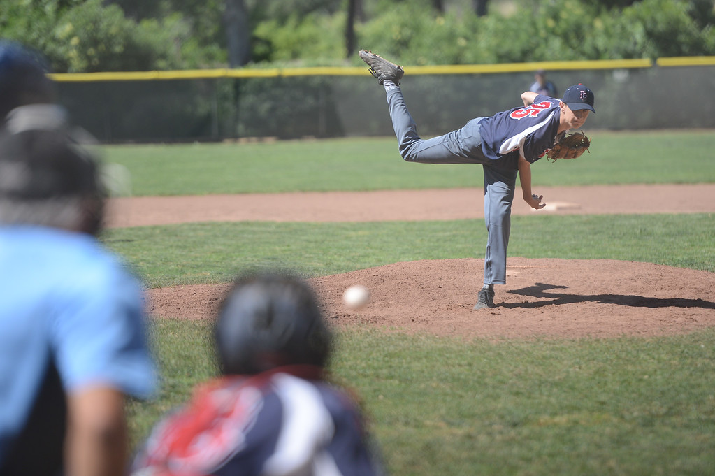 . Las Plumas High\'s Javier Martinez pitches the ball during a game against Pleasant Valley High, May 11, 2018,  in Chico, California. (Carin Dorghalli -- Enterprise-Record)