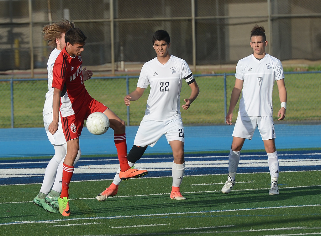 . University High\'s Marco da Cunha (7) gains control of the ball, Thursday, March 8, 2018, in Chico, California. (Carin Dorghalli -- Enterprise-Record)