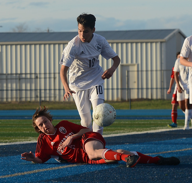 . University High\'s Luke Bronson (5) and Pleasant Valley High\'s Ari Reyes (10) fight for the ball, Thursday, March 8, 2018, in Chico, California. (Carin Dorghalli -- Enterprise-Record)