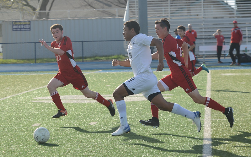 Pleasant Valley High's Dante Jackson (14) dribbles the ball as he's chased by University High's Ben Wadsworth (23) and Tiph Herrick (21), Thursday, March 8, 2018, in Chico, California. (Carin Dorghalli -- Enterprise-Record)