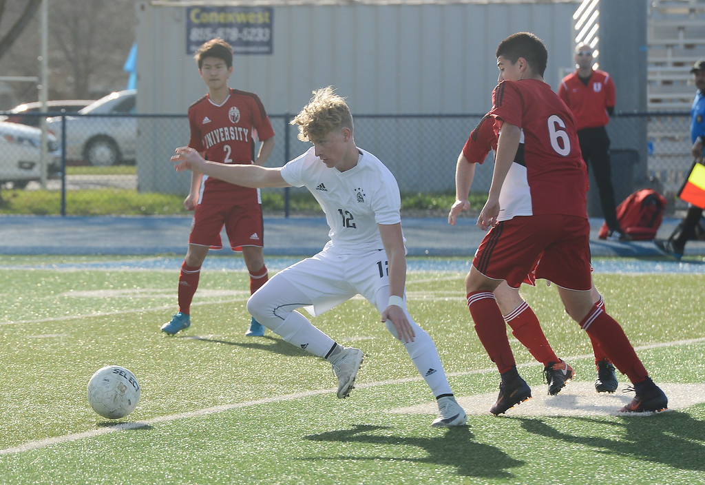 . Pleasant Valley High\'s Caden Crumm (12) gets the ball away from University High players, Thursday, March 8, 2018, in Chico, California. (Carin Dorghalli -- Enterprise-Record)