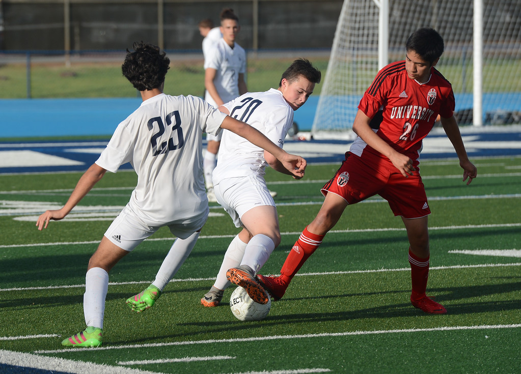 . Pleasant Valley High\'s Tomas Oliveras (23), Thomas Gevers (20) and University High\'s Carlos Jaramillo (26) go after the ball, Thursday, March 8, 2018, in Chico, California. (Carin Dorghalli -- Enterprise-Record)
