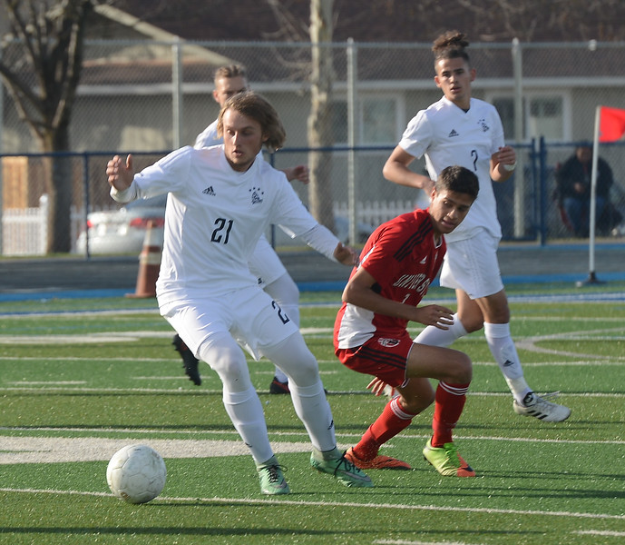 Pleasant Valley High's Logal Hall (21) gets the ball away from University High's Marco da Cunha (7), Thursday, March 8, 2018, in Chico, California. (Carin Dorghalli -- Enterprise-Record)